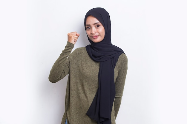Asian young muslim woman happy and excited celebrating victory expressing big success on white
