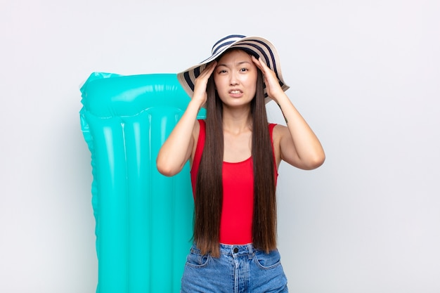 Asian young woman feeling frustrated and annoyed, sick and tired of failure, fed-up with dull, boring tasks. summer concept