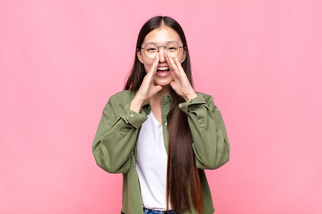Asian young woman feeling happy, excited and positive