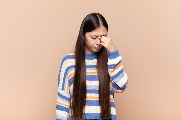 Asian young woman feeling stressed, unhappy and frustrated isolated