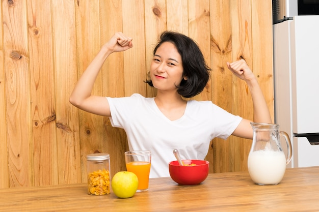 Asian young woman having breakfast milk celebrating a victory