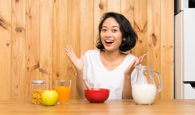 Asian young woman having breakfast milk unhappy and frustrated with something