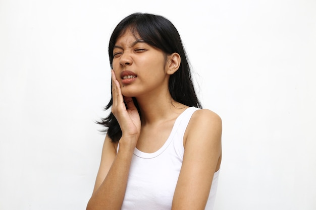 Asian young woman having toothache  on white