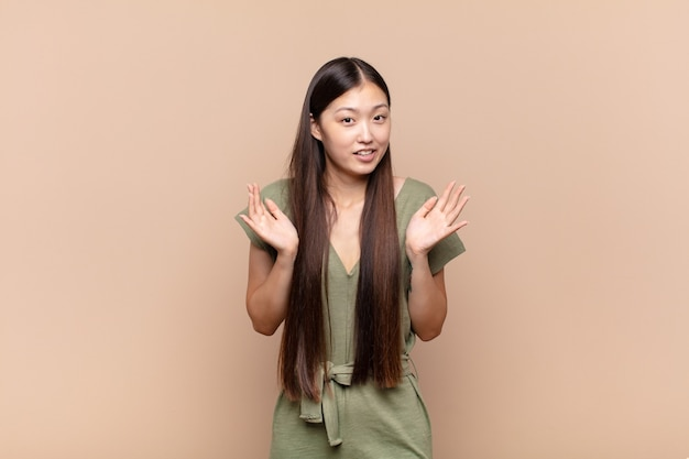 Asian young woman looking nervous, anxious and concerned, saying not my fault or i didn´t do it