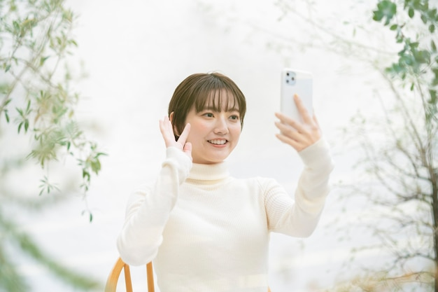 Asian young woman making a video call using a smartphone
