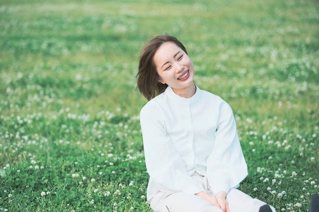 Asian young woman on the meadow