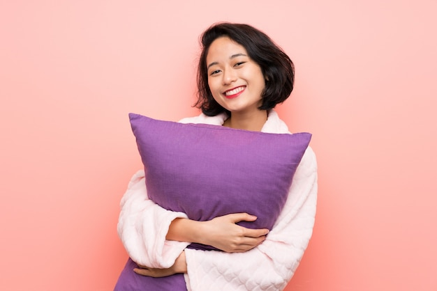 Asian young woman in pajamas