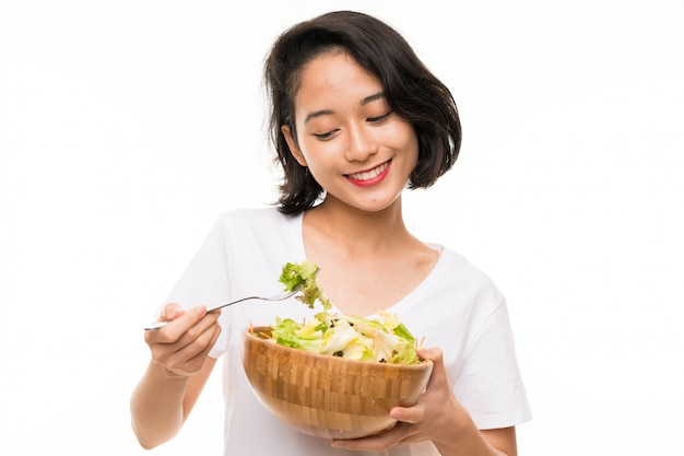 Asian young woman with salad