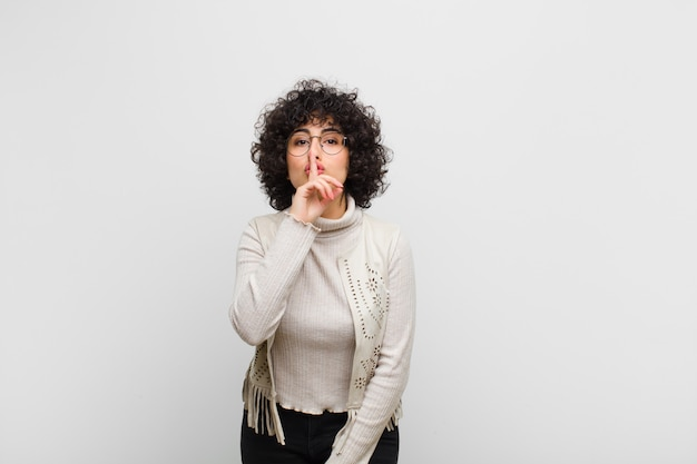Asking for silence and quiet, gesturing with finger in front of mouth, saying shh or keeping a secret