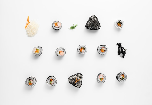 Asortment of maki sushi rolls n white background