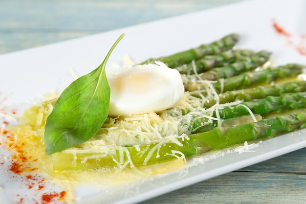 Asparagus with poached egg and parmesan cheese