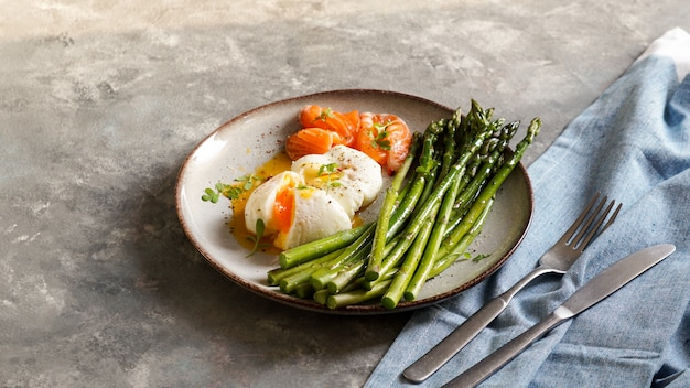 Asparagus with poached eggs ans salted salmon. tasty healthy breakfast