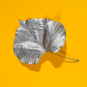 Aspen leaf dyed in silver water paint