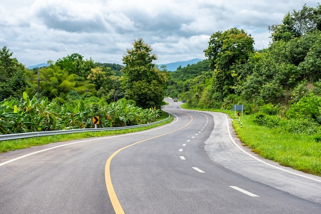 Asphalt highway curved with truck on hill