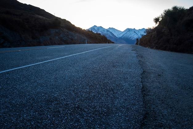 Asphalt highway of route no.6 lake hawea-wanaka town southland new zealand