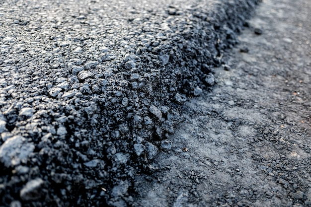 Asphalt layer just spread on a new road, detail