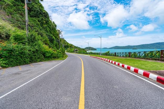 The asphalt road around the phuket island beautiful seashore in sunny summer day season amazing view blue sky background at phuket thailand.