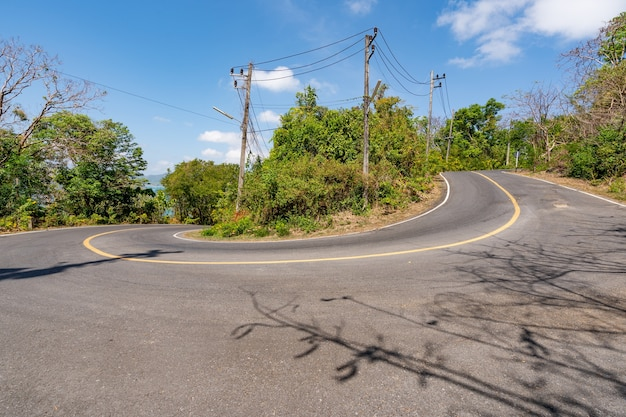 The asphalt road around the phuket island in summer season beautiful blue sky background at phuket thailand.