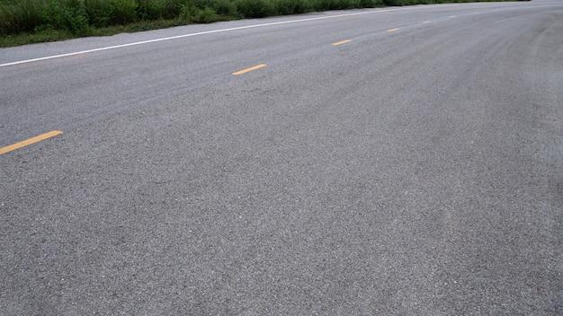 アスファルト道路の背景。タイのアスファルト道路。