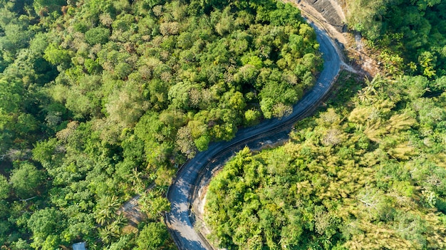 Asphalt road curve in high mountain image by drone bird's eye view