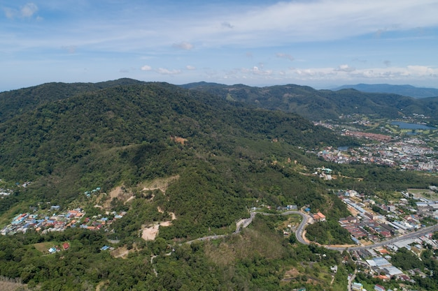 Asphalt road curve on high mountain in phuket thailand image by drone camera high angle view.