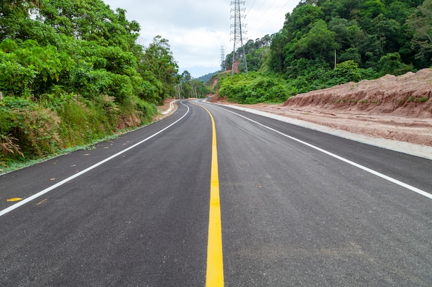 Asphalt road curve with yellow line on road