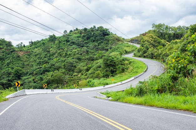 Asphalt road curved on hill