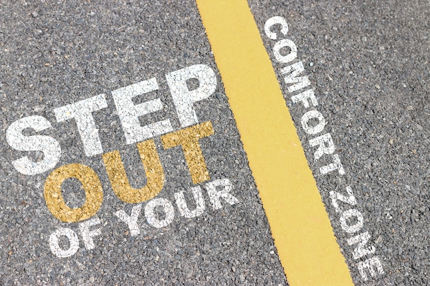 The asphalt road has a yellow stripe, inspiration typographic quotes.