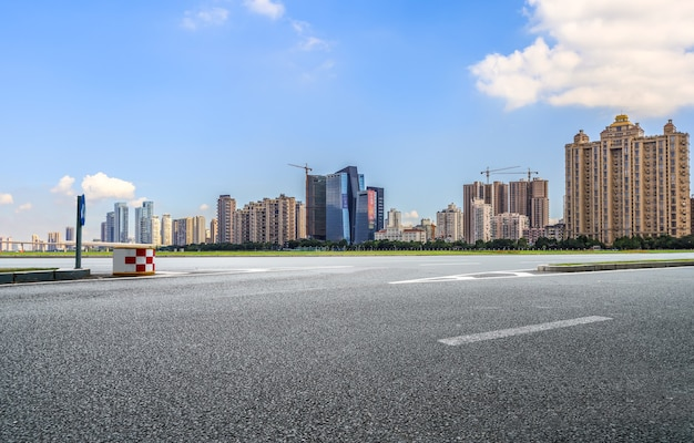 Asphalt road and modern architectural landscape skyline of chinese city