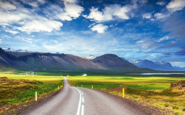Asphalt road to the mountains iceland.