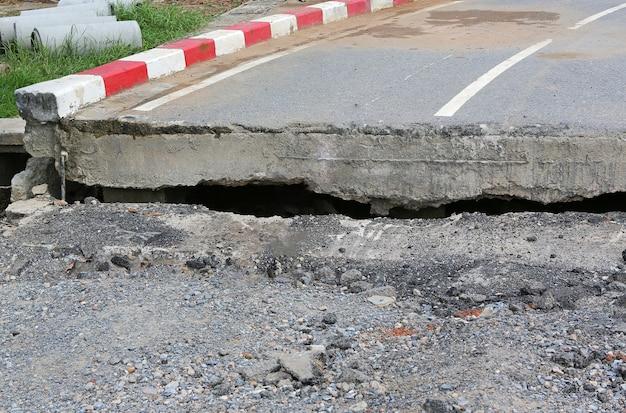 Asphalt road surface crack crash damaged