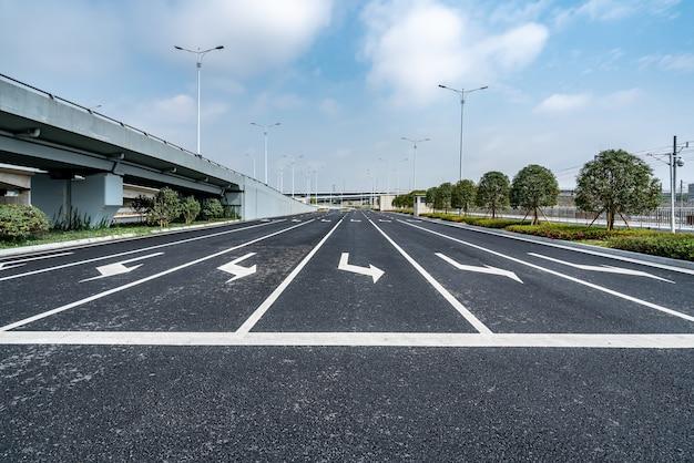 Asphalt road and urban viaduct