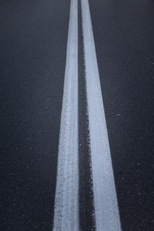 Asphalt road with marking lines white stripes.