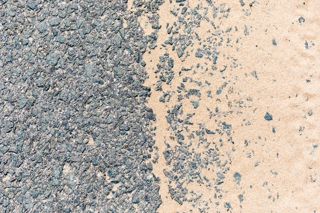 Asphalt road with sand