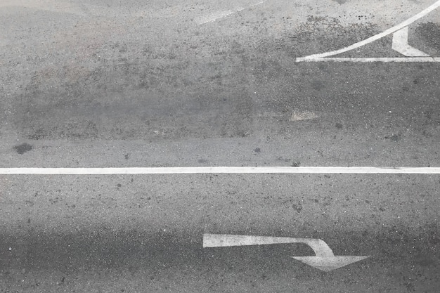 Asphalt road with turn symbol