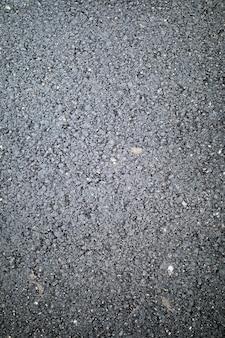 Trama di asfalto con ciottoli