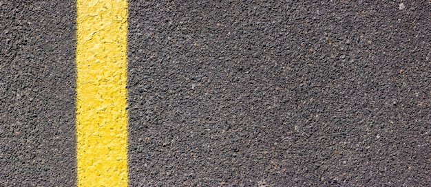 Asphalt texture with a yellow line on the left side