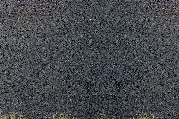 Asphalt used for surfacing roads or flooring, local street cover with asphalt, black rough textured background