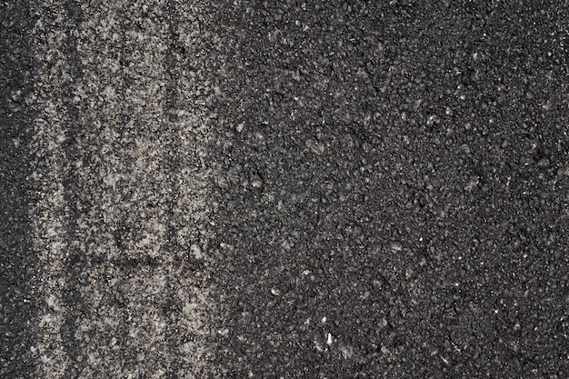 Asphalt with car trail as a background texture