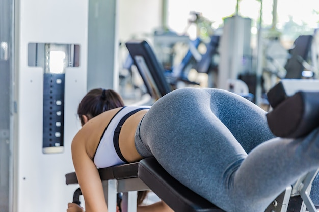 Ass girl close up. girl doing exercises on a simulator in the gym