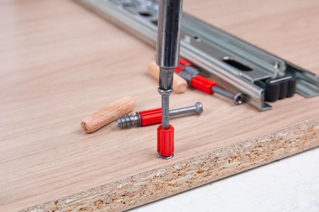 Assembling furniture using a screwdriver