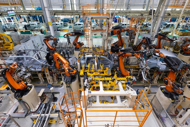 Assembly line in a car factory welding with robots automated work