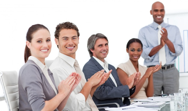 Assertive business people clapping a good presentation