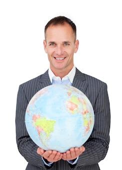 Assertive businessman holding a terreatrial globe