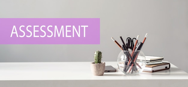 Assessment – text on the surface of the office table. business concept.