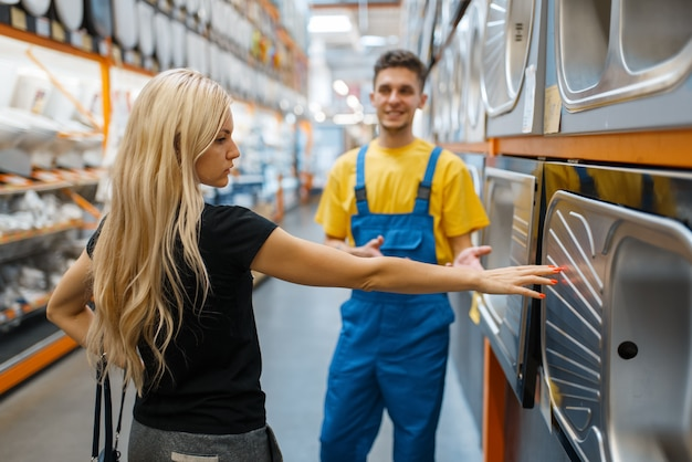 Assistant and female buyer in hardware store