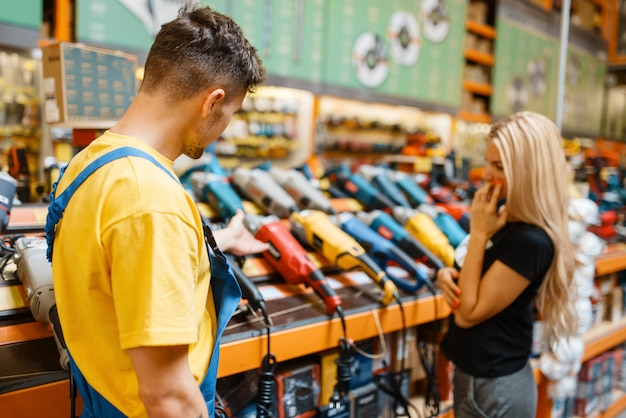 Assistant and female purchaser in hardware store