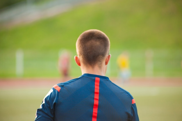 Assistant soccer referee in a soccer field with players