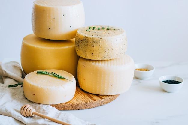 Assorted ?achotta cheese head with black cumin, fenugreek and herbs on white background
