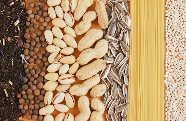 Assorted bulk grocery products texture top view copy space, spices, cereals and pasta